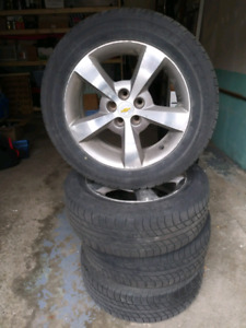 """17"""" Uniroyal tigerpaw touring on Chevy Rims."""