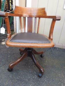vintage antique swivel office chair.. nice curved back