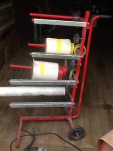 Paint booth paper dispenser