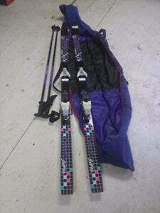 DOWNHILL SKIS, POLES, AND BAG
