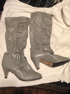 Womens high heeled high rise grey leather boots$20.00