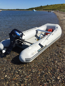 Inflatable and 9.8 Tohatsu outboard motor.