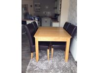 Solid oak extendable table and 4brown faux leather high back chairs