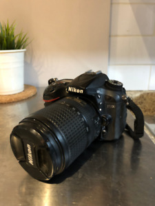 Nikon D7200 with 18-140mm lens and charger