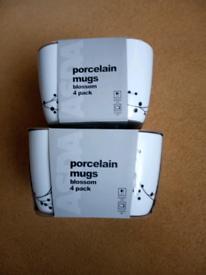 8 porcelain mugs brand new