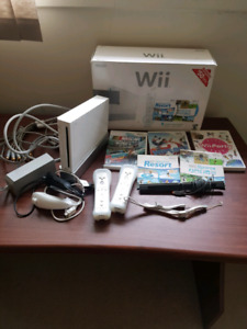 Nintendo Wii with cables, controllers, and games $90