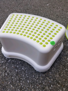 IKEA baby feeding chair and toddler step stools and potties.