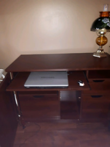Hidden computer desk inside cabinet