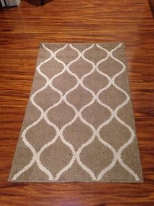 Brown and white floor rug