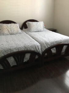 2 twin beds, 1 night table, 1 dresser with mirror and more