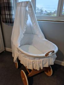 Large wooden wheeled Moses basket