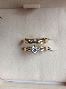 Diamond solitaire engagement and matching fitted wedding rings.