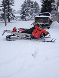 2011 Pro RMK 163'' with new engine.