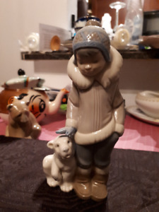 Vintage LLardro Eskimo boy with baby polar bear