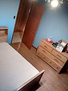 Twin bed with mattress, dresser, mirror, and chest