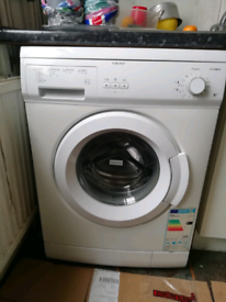 Curry's Essentials white washing machine 6kg 1000 spin A+ rated.