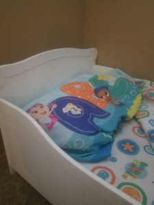 Toddler bed with mattress and bubble guppies bedding