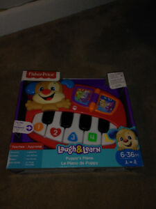 Fisher Price. Toy piano
