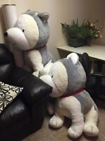 2 huge dogs stuffed animals.  AIRDRIE