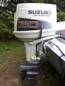 30hp Suzuki oil injected outboard with controls