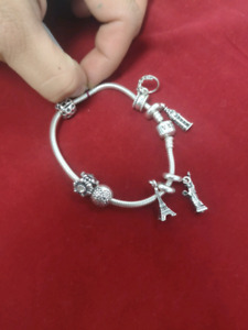 Authentic pandora bracelet with 6 charms