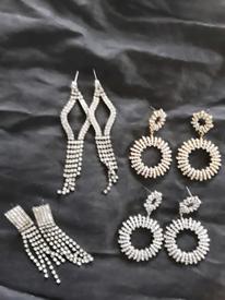 Four sets of ladies earrings.