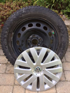 Set of 4 snow tires, rims and hubcaps from 2006 VW Passat