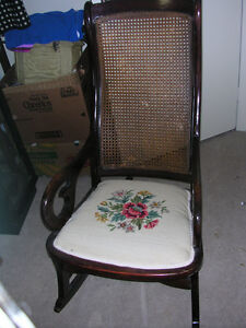 GENTLY USED DARK WOOD ROCKING CHAIR WITH NEEDLEPOINT SEAT CLEAN