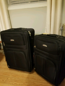 New never used Delsey Suitcases x2