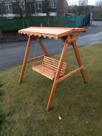 Wooden garden swing seat with roof