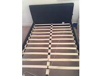 Black leather bed frame with slats