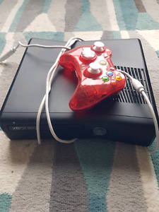 Black xbox 360 with 10 games and controller