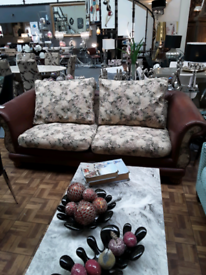 Large Leather and floral material Settee