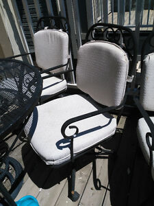 Cast iron patio set ! With 4 cast iron chairs