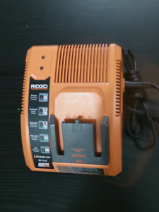 RIDGID,  Charger for Lithium- Ion/ Ni-Cad batteries.