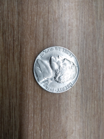 1976 American five cent coin.