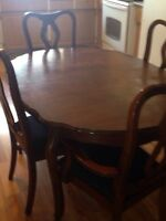 Cherry wood table and china cabinet