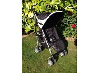 Silver Cross Pop Pink Bubbles stroller pushchair with raincover. Good clean condition .