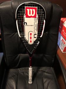 Wilson Ncore squash racquet and Dunlop Sport Pro squash ball