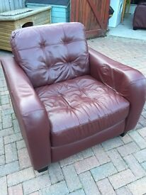 2 Leather snuggle arm chairs