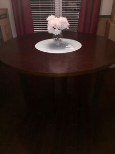 Round dining table- dark solid wood