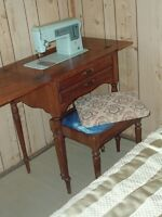 Singer sewing machine and console.  Separate matching stool, $40
