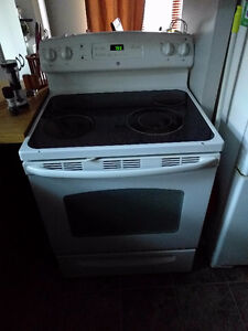 Clean, working, white stove with manuals