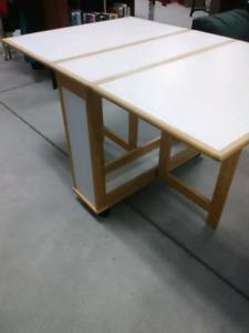 Heavy Duty 2 side fold down table on wheel, compact roll away.