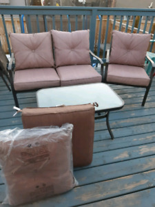 Patio set with extra set cushions