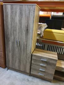 A new slight seconds oak effect finish 3 piece bedroom furniture set .