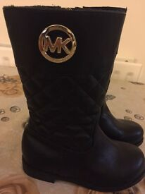 I have brand new authentic Michael kors black boots size 8 1/2 only £33