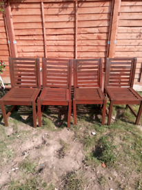 4 wooden garden chairs all been treated with wood paint