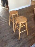 Two solid oak barstools.