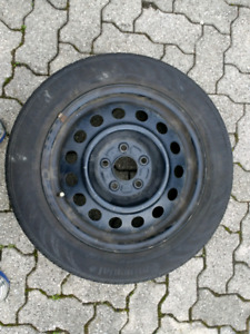 NEW PRICE . . .Four summer tires on steel rims 205-55-R16